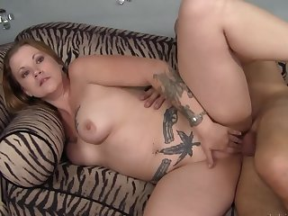 Cock in the curvy tattooed milf makes her moan like a slut
