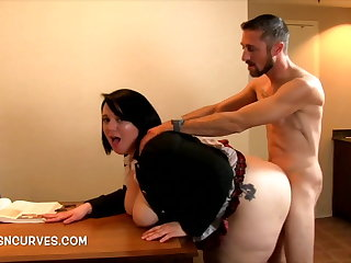Transcriber bent over a desk