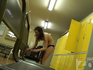 Pretty brunette undresses right at the of our hidden cam