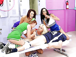 Jaelyn Fox and three around cheerleaders are busy with teasing big cock